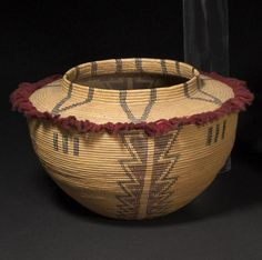 A Kawaiisu polychrome bottleneck basket with red wool tuffs