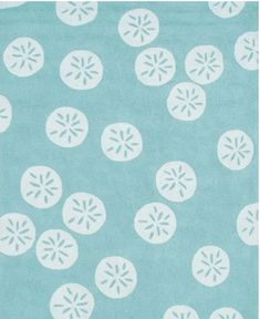 Project Nursery - This aquamarine sand dollar rug makes my mind wander to the ocean. The organic placement of the sand dollar motifs gives this piece a visual softness.