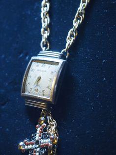 Golden vintage Bulova watch accent piece