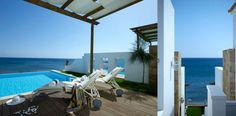 Sea view accommodation with a private pool & the Atrium Prestige signature. An inspired guestroom by the sea ideally located on Lachania beach in Rhodes. Atrium, Private Pool, Rhodes, The Prestige, Villas, Wind Turbine, Guest Room, Greece, Beach