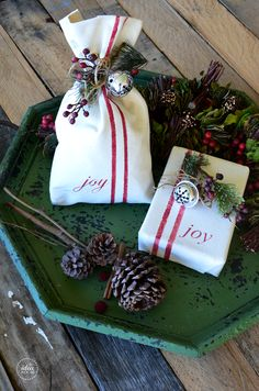 Cute gift wrapping idea, using drop cloth, stenciled with paint.