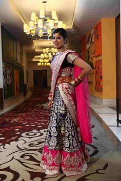 heavy lehnga in ink blue and hot pink
