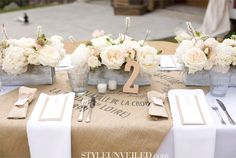 Burlap runner paired with an abundance of roses and crisp white linens is less shabby and more chic