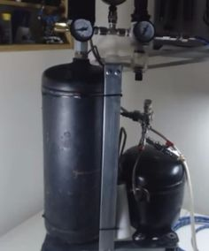 Silent Air Compressor - Homemade silent air compressor constructed from a refrigerator compressor, an air tank, pressure switch, and regulator.