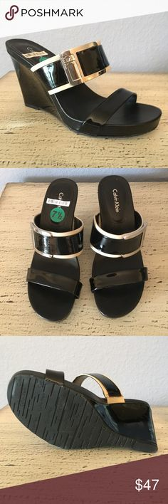 BRAND NEW-CALVIN KLEIN WEDGE SHOES WITH CK BUCKLE BRAND NEW-CUTE CALVIN KLEIN WEDGE SHOES WITH A LITTLE TAN TRIM. THESE SHOES ARE SO ADORABLE AND HAVE A NICE SILVER BUCKLE ON THEM THAT SAYS CALVIN KLEIN AND CK LOGO. CALVIN KLEIN Shoes Wedges