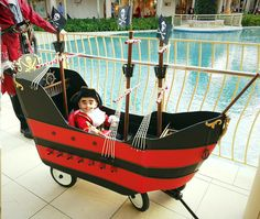8 month old Myles, dressed as Captian Hook, sits in his homemade, custom built, Jolly Roger Wagon Pirate Ship!