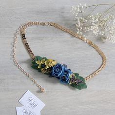 Cinturón con cadena dorada y flores en colores azules Es un cinturón  regulable que se confecciona d931d15cacf2