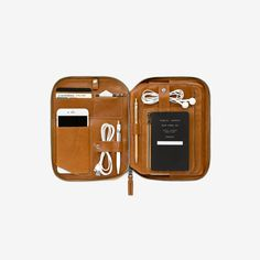 Mod Tablet 2 is a customizable carryall designed with a seamless magnetic spine that accommodates modular inserts. The interior of the Mod includes organization for tablet, phone, pens, stylus, glasses, cards, cash, notebook, small items, open compartments, and cords.