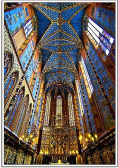 Krakow, Lesser Poland - This is the interior of the beautifully ornate St. Mary's Basilica in Kraków. Which was re-built in the 14th century, originally built in the 13th century. The Basilica which is a Brick Gothic Church is extremely tall and stands at 80 meters (262 feet) tall. The Basilica has been an architectural model for many churches built by the Polish abroad,