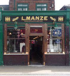 L. Manze Jellied & Hot Eels, Walthamstow High Street Built in 1929 designed by Herbert A Wright for Luigi Manze. it is listed at Grade II https://www.flickr.com/photos/shadow-in-the-water/15101522411/in/photolist-p1tfu4-ovUXnm-bfQtJT-of1wk7-oyaBHF-ovLfxJ-ovS3LU-owdV8N-oxQ7ZX-hm3VGU-oup9ZQ-oevFa9-oupyKy-owbrfM-our2uz-hm4Zog-hm3ZkJ-hm3V7d