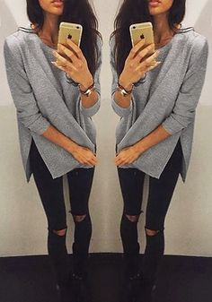 Give your winter staples a flirty twist with this grey side-slit oversized top.