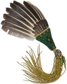 Wing fan with beaded thunderbird symbol on a green background by Tim Audiss (Sicangu/Lakota)