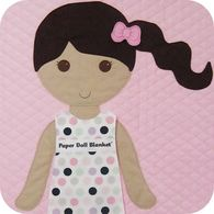 Paper doll blanket with interchangeable outfits and pocket flaps for the outfits in the blanket.