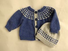 "This little sweater is a top-down round yoke knit, featuring a bit of slip-stitch colorwork. It is sized from newborn to 4T, and is appropriate for little boys and little girls alike. Also included are two additional sizes, meant to fit popular dolls: one for a 15"" baby doll (such as Bitty Baby) and one for an 18"" doll (such as American Girl)."