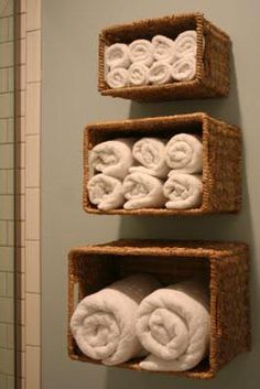 rolled towels stored in baskets on wall @Billie Jo Norsworthy Weisbrod