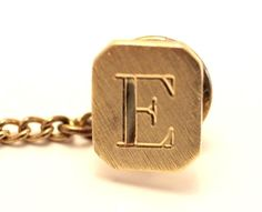 """""""E"""" Initial 