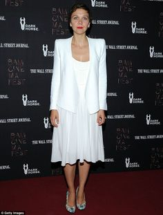 She's all white! Maggie Gyllenhaal stood out on the red carpet in a bright white ensemble, consisting of a blazer and flowing dress at a BAMcinemaFest screening http://dailym.ai/1pmxTbd