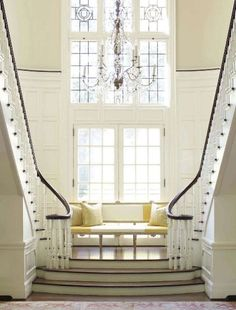 A yellow striped bench beckons between mirrored stairwells. Modern Home design. Modern home design Company Lo. Double Staircase, Grand Staircase, Staircase Design, White Staircase, Stair Design, Staircase Ideas, Home Interior, Interior Architecture, Interior Design