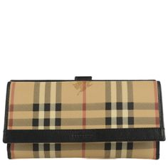 This is an authentic BURBERRY Haymarket Check Molly Continental Wallet in Black. The wallet is made of classic Burberry Haymarket check canvas with black leather trim. The flap opens to a matching leather interior with a panel of card slots, numerous patch pockets and bill folds. This is a fabulous clutch wallet that is as practical as it is chic with that fabulous look of tradition and sophistication, from Burberry.