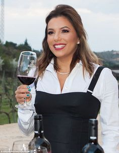 Chin chin:An apparent commitment to philanthropic endeavours proved worthy of a drink or two as Eva Longoria visited Spain¿s prosperous wine country on Thursday afternoon