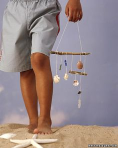 Shell Wind Chimes -  Any beachcomber will enjoy this project. Find two sticks 6 and 3 inches long. Use cotton string of  varying lengths; tie one end around a shell or piece of sea glass and the other end to one of the sticks. Use two same-size pieces of string to connect the sticks. Tie a 24-inch string to the top one to hang.
