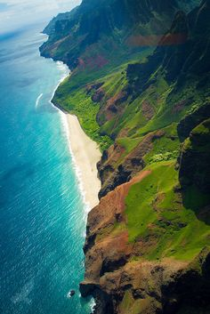 Waimea Canyon Raw (by Christian Arballo on Flickr)- The final lookout at the end of Waimea Canyon Road overlooks the Napali coast.  The height made me nervous and I stayed away from the edge, but I still saw an amazing view of the coast.  This photographer was daring and must have climbed down a bit for the breathtaking shot featured here.