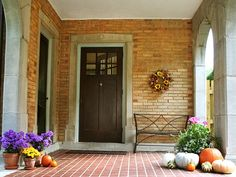 Nature Fall Porch Decorating Ideas With Bench Over Brick Stone Wall And Paving Flooring