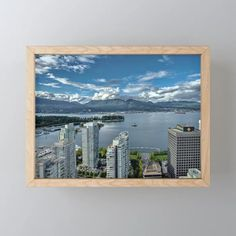Buy Vancouver Harbor Framed Mini Art Print by alexlyubar. Worldwide shipping available at Society6.com. Just one of millions of high quality products available. #AlexLyubar#FineArtPhotograpny#VancouverCanada#Downtown#Skyscrapers#VancouverHarbour#OceanShips#StenleyPark#MountainRange#CloudySky#ArtForHomt #FineArtPrint
