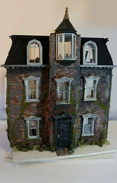 """""""Victorian"""" - The miniature three-story abode features blackened, moss-covered brickwork, climbing ivy and crackled window frames. - front"""