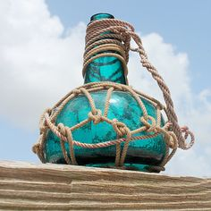 Vintage Aqua Blue Glass Pirates Rum Jug in Rope Netting by SEASTYLE