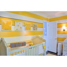 Yellow and white stripes on the wall create a cheerful atmosphere in the nursery. #rumahkubedroom