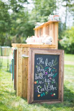 This colorful quote sign adds an extra touch of personality. Photo by Matthew Land Studios  via Style Me Pretty