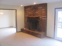 All brick, wood burning fireplace in the 12.6 x 17.6 living room.