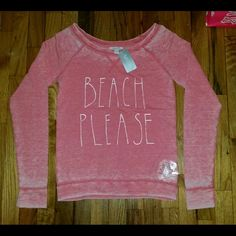 DeLiAs Beach Please Long Sleeve Top XS - NWT  Brand new, never worn, no damage.    Smoke-free, pet-free household.    No trades!   No swaps!   No holds!   No low-balling!   No PayPal!   ✔ Reasonable offers welcomed! Please use the offer button so I know you are serious about the item! I will not respond to price negotiations via comments.    Happy poshing!  DeLiAs  Tops Sweatshirts & Hoodies