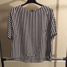 Plus Sized Striped Blouse This cool blouse has a modern boxier shape with a zipper opening in the back. Rock it cigarette pants or distressed jeans! Worn once and washed once. H&M Tops Blouses