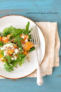 butternut squash, feta, and arugula salad - I usually add roasted pine nuts, asparagus, and grilled onions topped with a balsamic reduction. Delicious with goat cheese or parmesan as well!