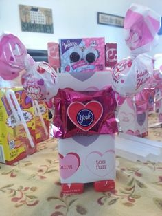 Valentine's robot.  Buy everything at Target.  Peanut free too. Hi-C juice box wrapped with Target dollar wrapping paper,  York for the heart,  Blow pops for the arms, nerds for the head and starburst for ears and legs. On the back on the nerds is where you put the to and from at.