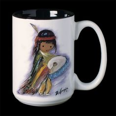 """DeGrazia® Ceramic Mugs - """"Pima Indian Drummer Boy Mug"""". These beautiful DeGrazia® Ceramic Mugs stand 4 1/2″ tall with a 3″ diameter and hold 15 oz. of liquid. There is a DeGrazia® print on two sides along with his signature. The inside is finished with a black glaze. These mugs can be used for either hot or cold beverages.  $21.95"""