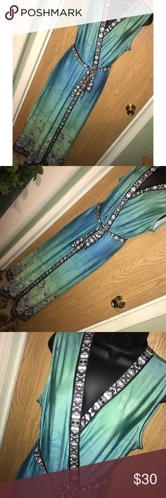 """Watercolor printed trim maxi dress Gorgeous watercolor and printed trim maxi dress. Waist tie. ❗️Please no low ball offers.❗️ ❗️Bundles always get a discount.❗️ Condition: Great, used  Measurements- Armpit to armpit: 21"""" Total length: 54""""  Smoke free home but I have a small dog.  Thanks for checking out my closet! ❤️ New York & Company Dresses Maxi"""