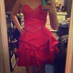 WORN ONCE!! BEAUTIFUL CORAL BEADED DRESS! Gorgeous coral beaded dress. It is strapless with beautiful beading on upper part of dress. It has a balloon hem. Worn once and dry cleaned ready to wear!! MASQUERADE Dresses