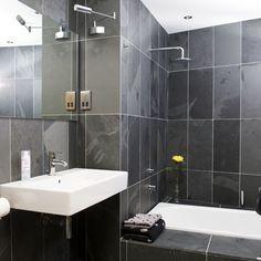 Small black bathroom Understated white sanitaryware provides a contrast to the dark slate walls int this bathroom. Dark Gray Bathroom, Grey Bathroom Tiles, Bathroom Color Schemes, Grey Bathrooms, Beautiful Bathrooms, Modern Bathroom, Bathroom Ideas, Bathroom Designs, Shower Ideas
