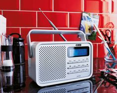 High-gloss DAB/FM Radio in sleek white. The perfect blend of style and sound this Acoustic Solutions radio is exclusive to Argos. The neat and compact design plus both mains and battery power, make this the coolest of portable radios. Argos, High Gloss, Acoustic, Compact, Layouts, Cool Stuff, Design, Products, Style