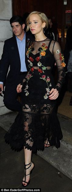Jennifer Lawrence flashes her black bra in a chic sheer dress #dailymail
