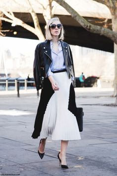 25 Ways to Wear Midi Skirts - over-the-shoulder leather moto jacket + blue button-down shirt and pleated black and white midi skirt with classic pointy heels   StyleCaster