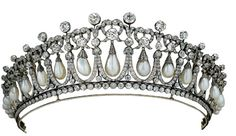 Mary's own design in 1914 using pearls & diamonds that she owned is a copy of a tiara owned by her grandmother, Princess Augusta of Hesse. She had been given it by her family prior to her marriage. strong French influence in the design of the 19 arches, each enclosing an oriental pearl suspended from diamond lover's knots & surmounted by single diamonds and upright pearl spikes. Elizabeth II gave it to Diana as a wedding present & she wore it often during her marriage to Charles.