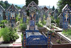 Romania - The Merry Cemetery (Cimitirul Vesel) - Săpânţa. The more than 800 painted crosses constitute a vast archive that preserves, carved in wood, the stories of the people of Săpânţa Oh The Places You'll Go, Places To Visit, Old Cemeteries, Tourist Places, Cross Paintings, Mansions, World, House Styles, Pictures