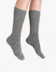From Hue, a simple mid weight modern marled boot sock. Features an ultra soft cotton blend, padded foot and ribbed texture.   •	Marled boot sock •	Ultra soft •	Ribbed cuff •	Padded foot •	45% cotton, 41% rayon, 13% nylon, 1% spandex •	Machine wash