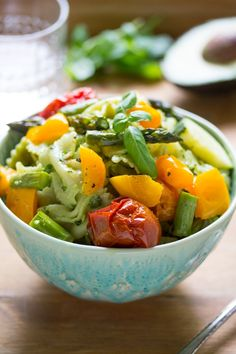 Creamy, delicious avocado pesto dresses this roasted summer vegetable pasta salad. An easy weeknight meal, this comes together in 35 or so minutes!