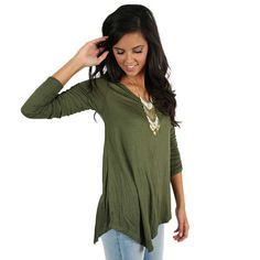 Not Your Boyfriend's Tee Olive | Impressions Online Women's Clothing Boutique Basics don't have to be boring! This v-neck tee features fitted sleeves and an asymmetrical hem. Dress it up with a statement necklace and skinnies. You'll look perfect for any occasion!