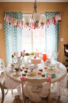 sweet tea party.  love the lace and doily chair swags.